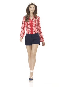The big bold print in the red shirt would completely drown out a petite woman or someone with lighter hair and skin.